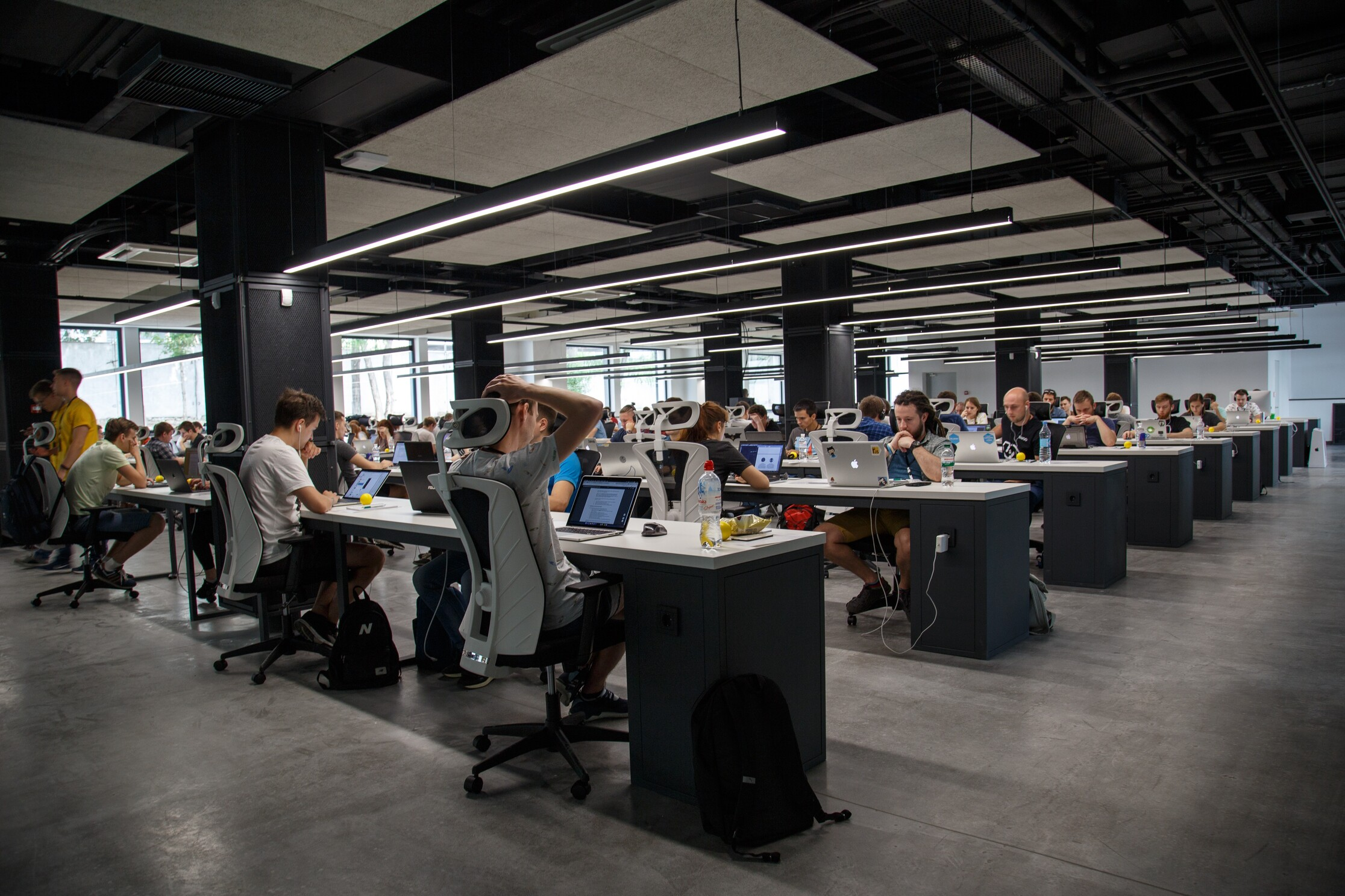 workers working from a traditional office before the new normal shift towards remote work