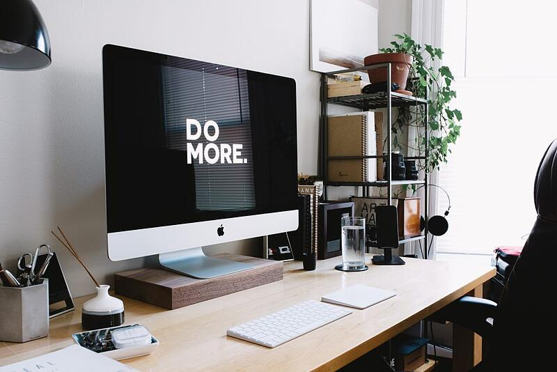 Remote worker's working from home set up with a productivity motivating screensaver