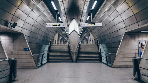An empty London underground tube station with no commuters as the workplace becomes less capital centric.