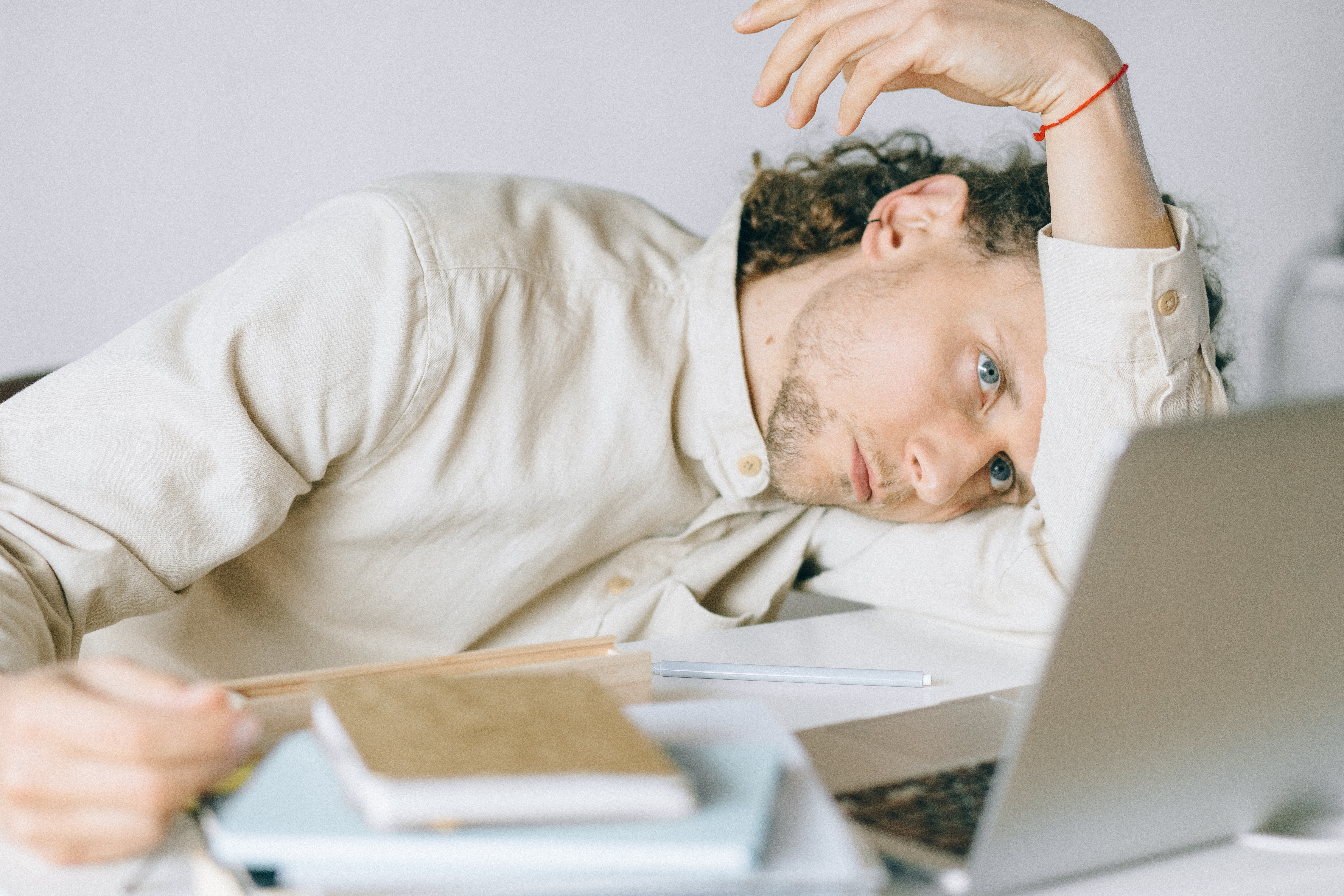 remote worker experiencing the struggle of zoom fatigue and pandemic workplace burnout